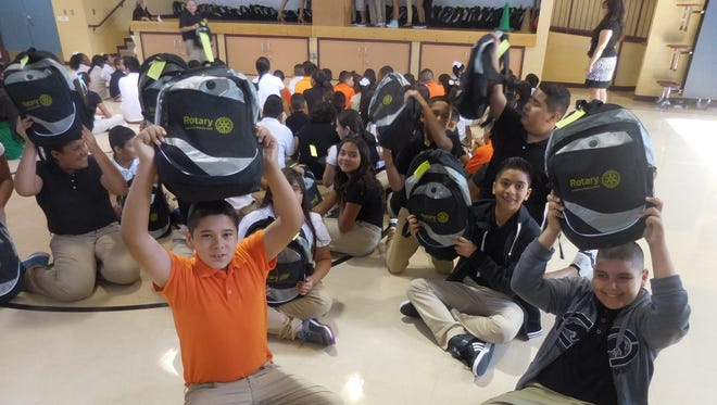 Daniel Garcia, left, and Gabriel Mendez, sixth-graders at Gadsden Elementary, hold up backpacks filled with school supplies provided by the Anthony Rotary Club. The club assisted  four schools in the district.