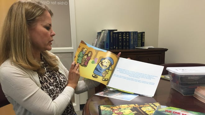 Jill Toth reads from part of an Orbie for Orphans lesson.