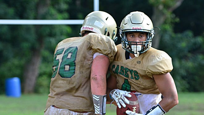 Running back Anthony Summey (right), shown practicing with Red Bank Catholic in August, has transferred to Middletown South.