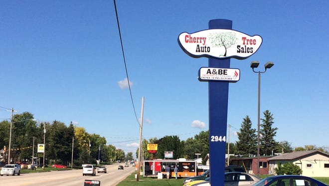 Cherry Tree Auto Sales has moved from Bowen Street to 2944 Jackson Street after an arson last year.
