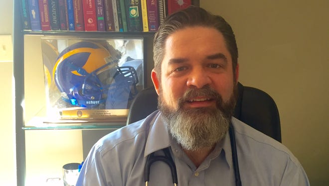 Doctor Robert Wilson of Covenant Care Practices in Erin, Tennessee is the new sideline physician for the Houston County High School Fighting Irish football team.