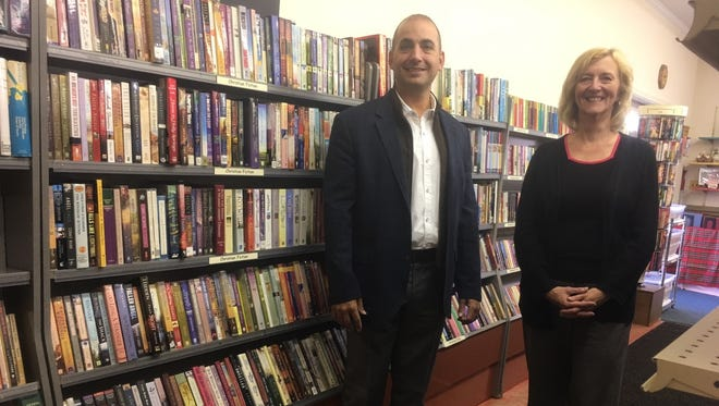 Jody Cole, right, director of the Shippensburg Public Library, stands with local businessman Don Nori, in the renovated Book Nook where Nori donated new shelves.