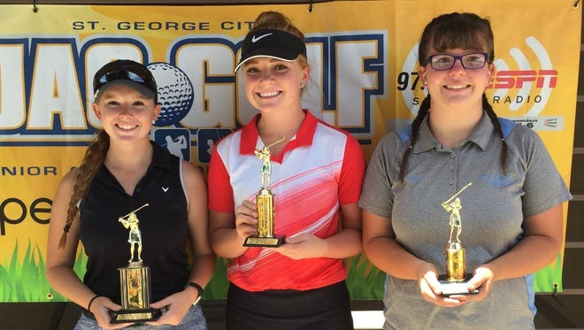 Golfers pose for a picture at the St. George Golf Club on Wednesday during the second JAG tournament of the summer.