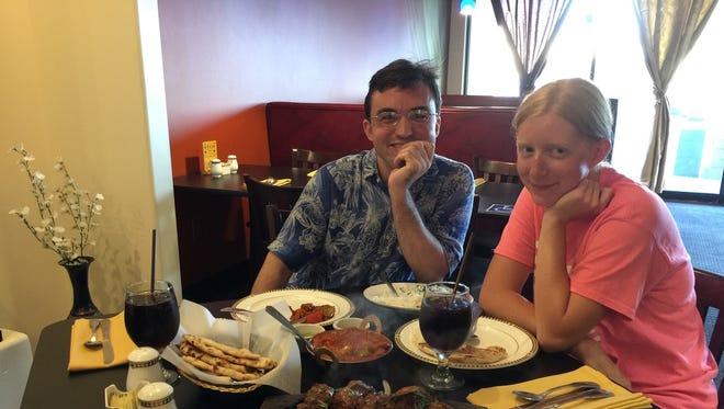 James Hennig and Nicole Sutherland share Indian food at Taj Mahal in Redding.