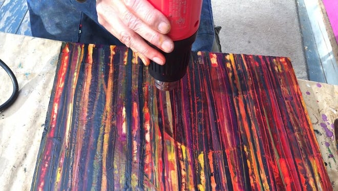 Artist Hilary Gifford demonstrates her process at her studio on Main Street in Trumansburg.