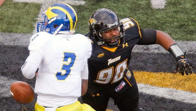 Delaware quarterback Joe Walker is stripped of the ball by Towson defensive lineman Zain Harps Upshur in the third quarter of the Blue Hens' 19-0 loss at Johnny Unitas Stadium Saturday.
