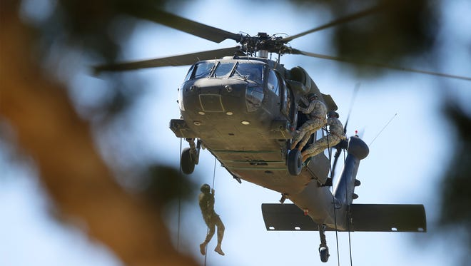 Members of Headquarters and Headquarters Battalion went through air assault training to build esprit de corps and to make sure this key support unit is combat ready. A rappelling exercise was held at Noel Field just off of Cassidy Road in the center of old Fort Bliss.
