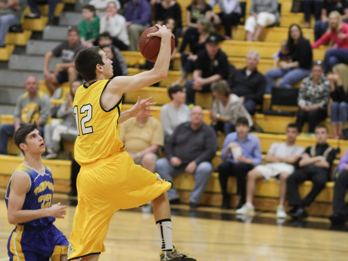 Bishop Verot senior Thaddeus Ward goes up for a layup on Jan. 22 against Charlotte on senior night. The Vikings lost 68-65.