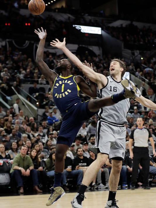 Indiana Pacers guard Lance Stephenson (1) and San Antonio Spurs center Pau Gasol (16) reach for a rebound during the first half of an NBA basketball game, Sunday, Jan. 21, 2018, in San Antonio. (AP Photo/Eric Gay)