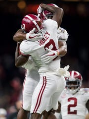 Alabama wide receiver Calvin Ridley (3) celebrates with running back Damien Harris (34) after scoring a touchdown against Clemson in first half action in the Sugar Bowl at the Superdome in New Orleans, La. on Monday January 1, 2018. (Mickey Welsh / Montgomery Advertiser)