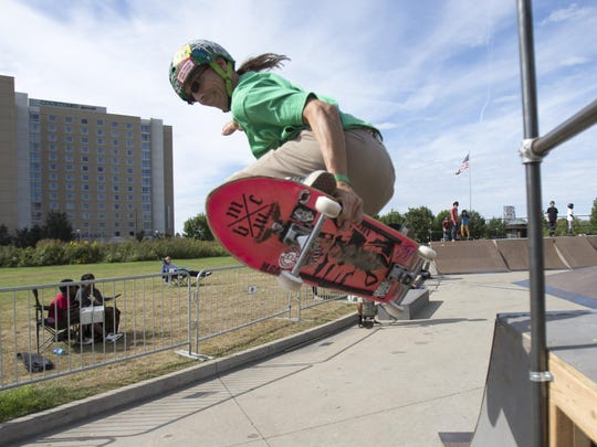 Michael Gage, Indianapolis, does a trick at a skatepark that was installed in front of the Indiana State Museum.