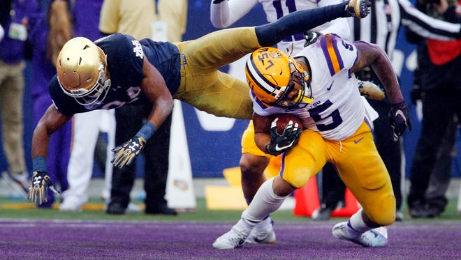 LSU running back Derrius Guice scores a touchdown on Notre Dame safety Nick Coleman in the Citrus Bowl, Jan. 1, 2018.