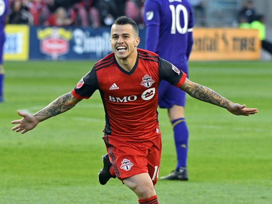 Toronto FC's Sebastian Giovinco celebrates one of his
