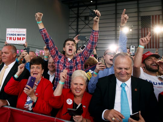 Supporters of Republican presidential candidate Donald Trump cheer as he arrives to a campaign rally, Friday, Nov. 4, 2016, in Wilmington, Ohio. (AP Photo/ Evan Vucci)