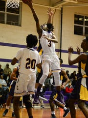 Crisfield's Rykell Waters goes to the basket against Pocomoke High school during the MPSSAA 1A East Playoffs in Crisfield on Monday, Feb. 27, 2018.