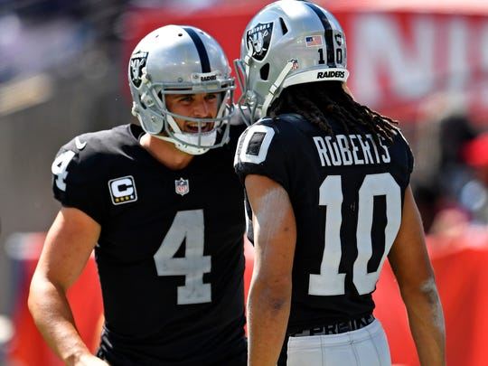 Raiders quarterback Derek Carr (4) congratulates wide receiver Seth Roberts (10), who caught a TD pass in the fourth quarter Sunday, Sept. 10, 2017, at Nissan Stadium.