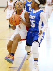 Charlotte Dugas tries to make a basket during the LHSBCA