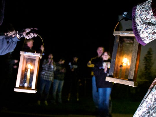 """Johlene """"Spooky"""" Riley, left, and Ginger Betz, of Gettysburg Ghost Tours, hold lanterns while giving a ghost tour in Gettysburg."""