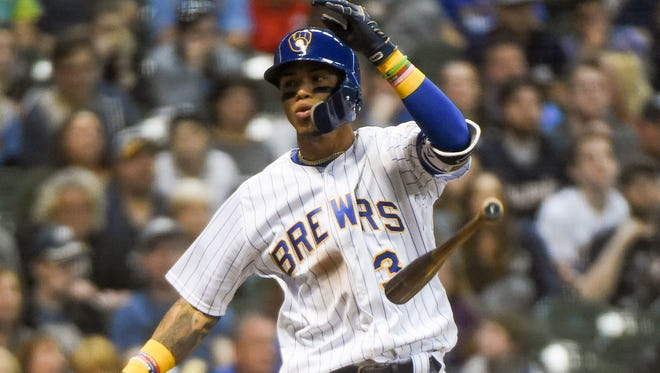 A disgusted Orlando Arcia flips his bat aside after striking out to end the eighth inning with a pair of runners on base against the Pirates on Friday night.
