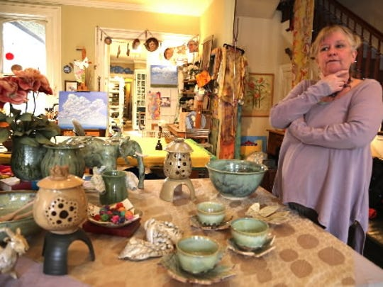 Kim Heindel-Toner, organizer of the Makers Dozen Tour, stands among her handmade pottery items at her studio and shop Terra Opera Pottery in York.
