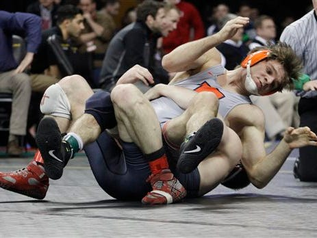 Illinois' Steven Rodrigues, top, competes with Nebraska's Austin Wilson in a semifinal at 165 pounds during the Big Ten wrestling championships in Iowa City, Iowa, on Saturday, March 5, 2016. (AP Photo/Matthew Holst)