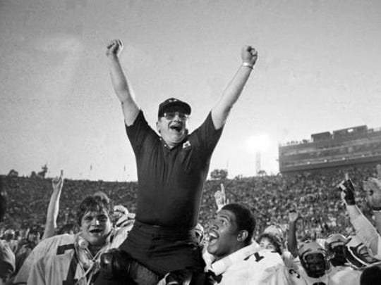 In this Jan. 1, 1981, file photo, Michigan coach Bo Schembechler is carried from the field by Glen Dwyer (71) and Ed Muransky, left, after a 23-6 win over Washington in the Rose Bowl in Pasadena, Calif.  No. 7 Michigan (894 points)  Total appearances: 806, 73.07 percent of all polls.  First appearance: 1938.  No. 1 rankings: 34.  Championships: Two (last 1997).  Best full decade: 1970s appeared in 100 percent of polls.  Worst full decade: 1960s appeared in 26.98 percent of polls.  Poll point: The Wolverines were first team to appear in every poll over the course of a full decade, when they did it in the 1970s under coach Bo Schembechler.