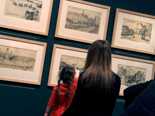 "In this Nov. 21, 2016, photo, a girl points at sketches featuring the classic children's story ""Make Way for Ducklings"" at an exhibit at the Museum of Fine Arts in Boston. The new exhibition is devoted to Robert McCloskey, the award-winning author of 1941's ""Make Way for Ducklings"" and other children's classics."