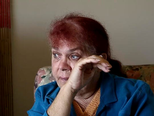In this Aug. 15, 2016 photo, Thelma Davis cries as she talks about the death of her daughter, Lynette Daley, at her home in Yamba, Australia. The brutal death of Daley, an Aboriginal woman, and the reluctance of officials to prosecute the white suspects, has highlighted a deadly racial divide in Australia, where Indigenous people remain the most disadvantaged segment of society.