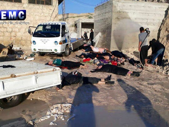 This photo provided Tuesday, April 4, 2017 by the Syrian anti-government activist group Edlib Media Center, which has been authenticated based on its contents and other AP reporting, shows  victims of a suspected chemical attack, in the town of Khan Sheikhoun, northern Idlib province, Syria. The suspected chemical attack killed dozens of people on Tuesday, Syrian opposition activists said, describing the attack as among the worst in the country's six-year civil war.