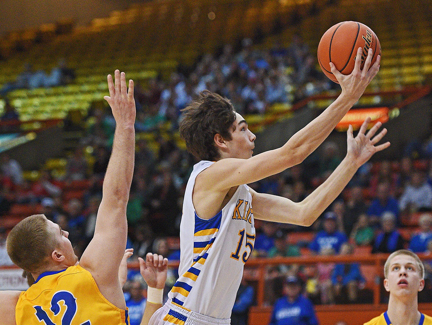 O'Gorman's Joey Messler (15) goes up for a shot over Aberdeen Central's Collin Stoebner (12) during the 2017 SDHSAA Class AA State Boys Basketball championship game Saturday, March 18, 2017, at Rushmore Plaza Civic Center in Rapid City.