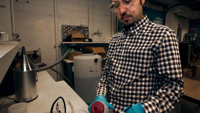 Ali Amiri, a PhD candidate in chemical engineering at New Mexico State University tests the PH, electrical conductivity, and total dissolve solids of brackish water on Tuesday.