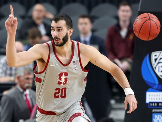 Stanford's Josh Sharma reacts after scoring during the first half of an NCAA college basketball game against California in the first round of the Pac-12 men's tournament Wednesday, March 7, 2018, in Las Vegas. (AP Photo/Isaac Brekken)