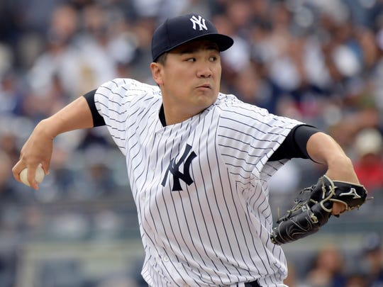 New York Yankees pitcher Masahiro Tanaka delivers the ball to the Boston Red Sox during the first inning of a baseball game Saturday, Sept.2, 2017, at Yankee Stadium in New York. (AP Photo/Bill Kostroun)