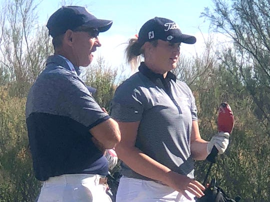 Last season's sophomore sensation Presley Jackson chats with Deming High Golf Coach James Williams before play at a 2018 out-of-town tournament.