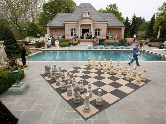 A chess board on the pool terrace with the garden pavilion in the background is seen at the French-style mansion once owned by former Conseco CEO Stephen Hilbert.
