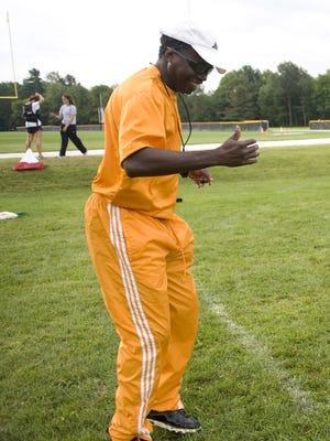 St. Ambroise Azagoh-Kouadiohone (Azzie) coaches Rice Memorial High School during a practice in August, 2010.
