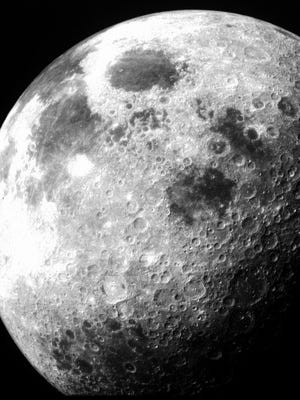This is a side view of the moon photographed by the Apollo 12 crew in November 1969. This angle is never viewed from Earth. On the lunar horizon at the far upper left is a foreshortened view of the Sea of Tranquility, where the Apollo 11 astronauts landed, in July 1969.