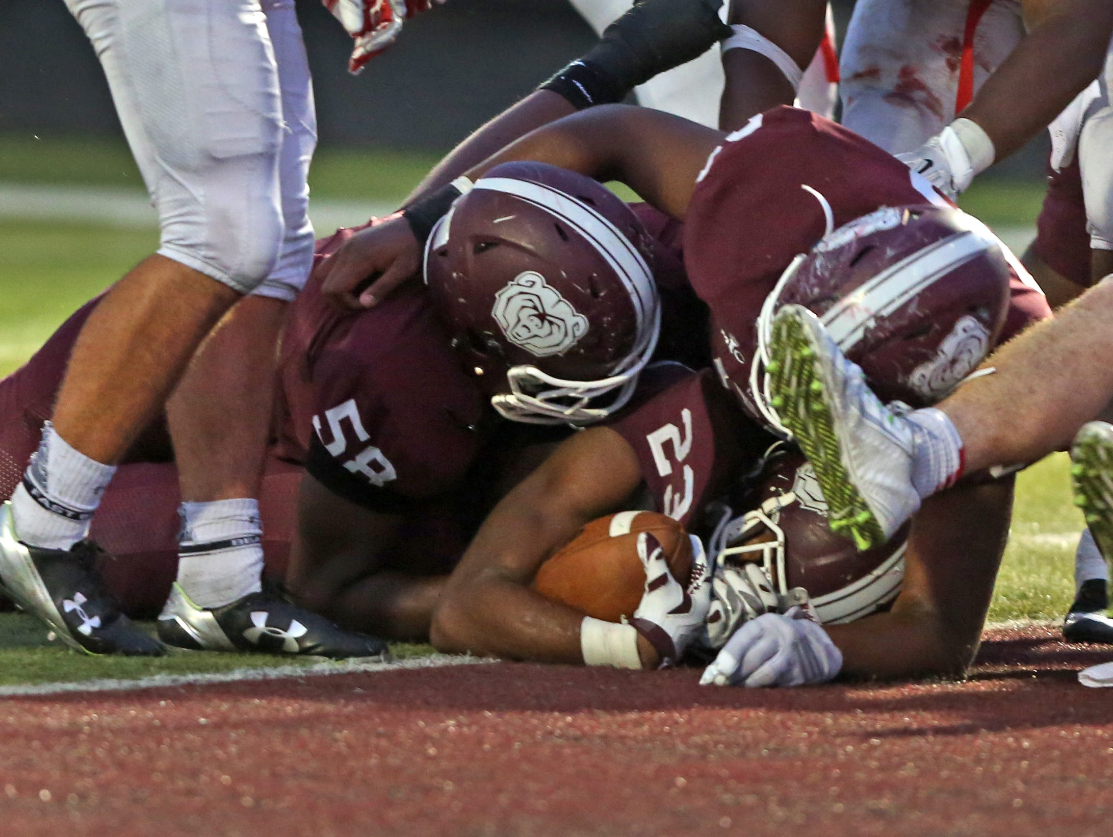 Lawrence Central's #23 Gerrid Doaks crosses the line for a touchdown during the Center Grove at Lawrence Central football game, Friday, September 25, 2015. Lawrence Central led 12-7 by halftime.