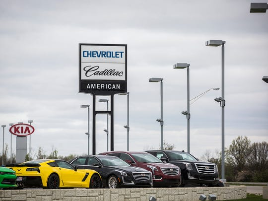 A Chevrolet pole sign stands on McGalliard Road Friday.