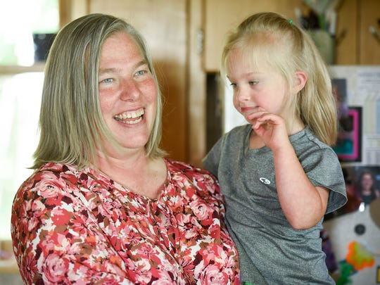 Cyndi Walls with her daughter Kira, 4, talks about her volunteer work at St. Mary's Help of Christians Church and as a 4-H leader Wednesday, July 5, at her home in St. Cloud. Walls was selected by the St. Cloud Times for the ChangeMaker award from St. Cloud Federal Credit Union for her work.