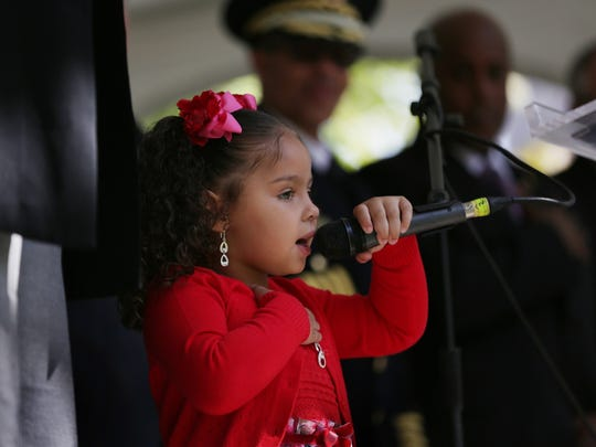 Jayla Nicole Parish, 3 leads the Pledge of Allegiance during a memorial service remembering the victims of 9/11 in Detroit on Monday, September 11, 2017.