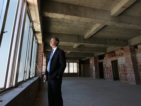 Gerald Cichon, Housing Authority of El Paso CEO looks out from the 16th floor of the Blue Flame Building in Downtown El Paso. That floor and two other top floors will be offices in the building being renovated by the agency for low-income apartments and offices.