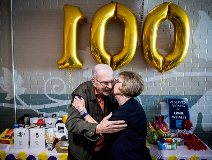 Ernie Whaley, 100, is kissed by a fellow mall walker