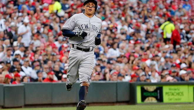 New York Yankees third baseman Ronald Torreyes (74) scores in the second inning during the interleague baseball game between the New York Yankees and the Cincinnati Reds, Monday, May 8, 2017, at Great American Ball Park in Cincinnati.