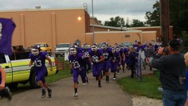 The Mt. Gilead Indians run out to a cheering home crowd before their game against Northridge on Friday, Sept. 12, 2014.