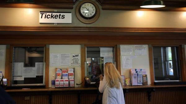 A woman buys a train ticket at the New Rochelle train station on June 3, 2014.  New Rochelle is setting out on a major transit-oriented development plan, joining similar, if smaller plans in communities such as White Plains, Yonkers and Harrison.
