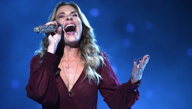 LeAnn Rimes performs during CMA's Country Christmas special taping at the Grand Ole Opry on Nov. 7, 2015.