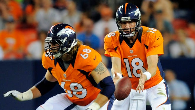 FILE - In this Aug. 18, 2012, file photo, Denver Broncos quarterback Peyton Manning (18) takes the snap as guard Zane Beadles (68) protects during the first half of a preseason NFL football game against the Seattle Seahawks in Denver.