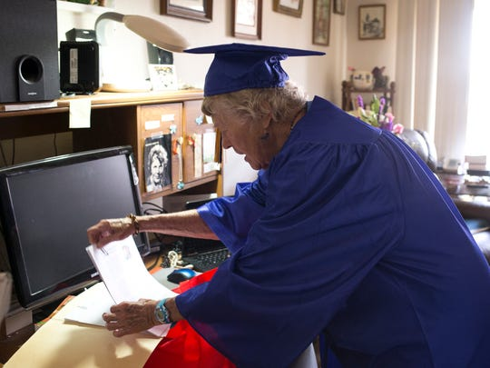 Mariam Cheshire, 88, grabs her graduation speech, May 12, 2016, in her apartment at Silvercrest Senior Residence Center, 613 N. 4th Ave. Phoenix. Cheshire graduated from Phoenix College after taking one science class to finish a degree she started in 1945 at Indiana State University.