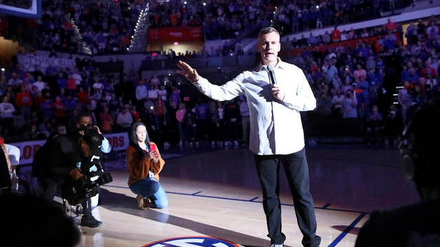 Former University of Florida head coach and Gator legend Billy Donovan talks to the crowd Saturday as the court is renamed Billy Donovan Court during a game against Vanderbilt, in Gainesville, Fla. on Saturday.